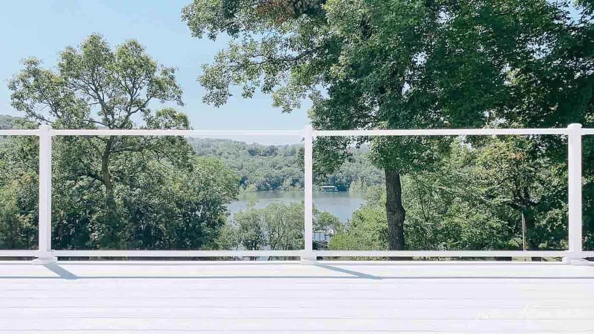 White vinyl decking with a lake view in background.