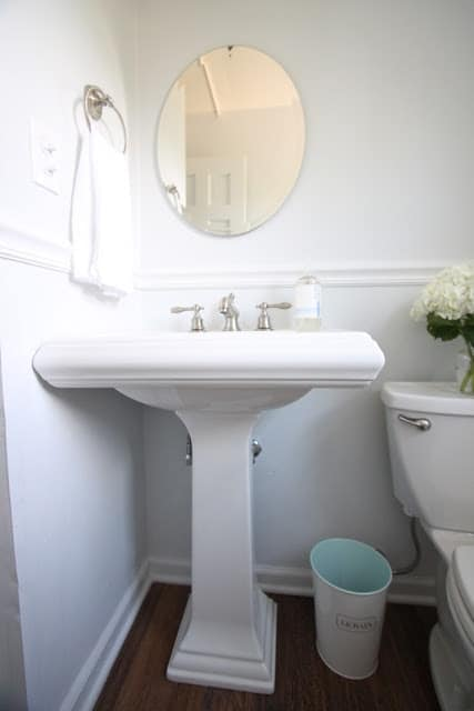 A bathroom painted in SW Rhinestone, pedestal sink in foreground.