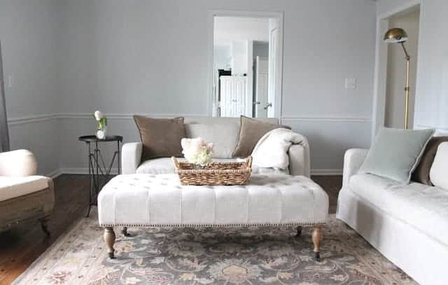 A neutral living room with walls painted in a soft gray called Sherwin Williams Rhinestone.