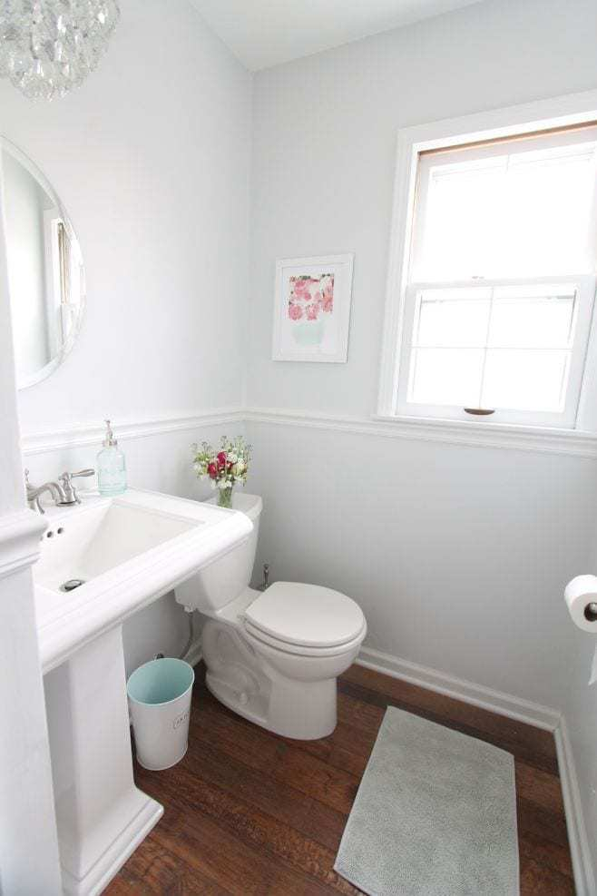 A white bathroom with walls painted in Sherwin Williams Rhinestone.