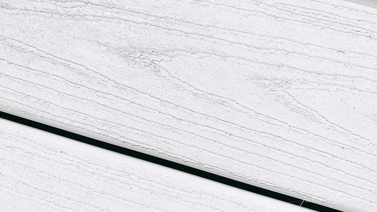 Stripes of white vinyl decking.