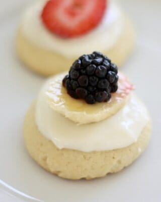 a white plate with fruit pizza cookies