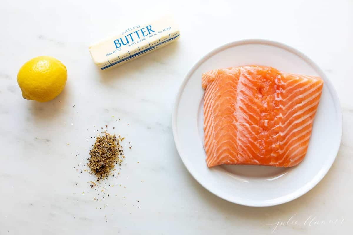 Fresh ingredients for lemon pepper salmon.