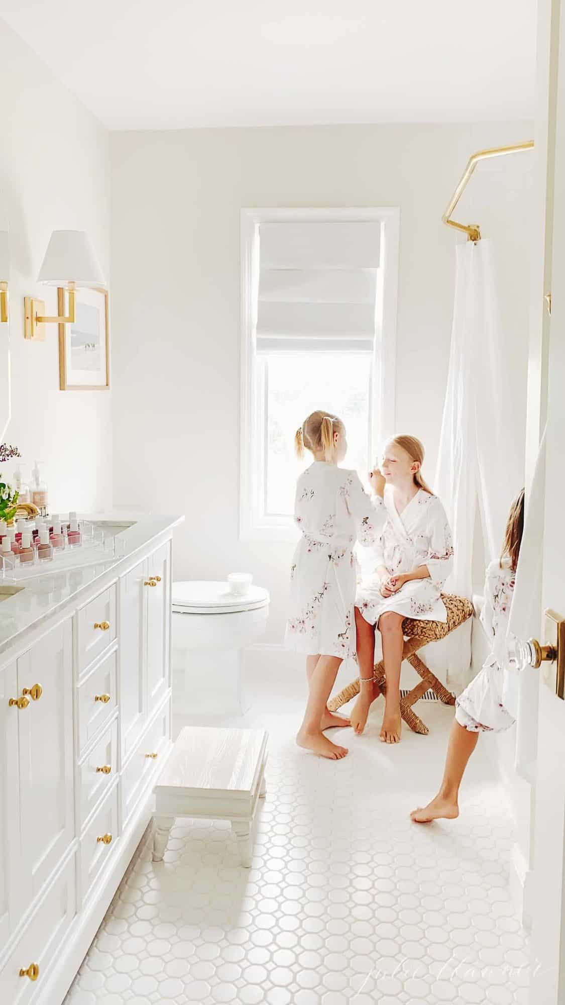 girls playing spa in white bathroom