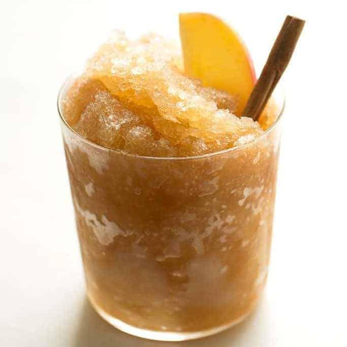 apple cider slush garnished with cinnamon stick and apple slice