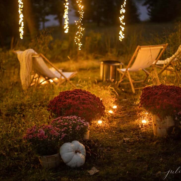 chairs by fire with candlelight mums and pumpkin decor