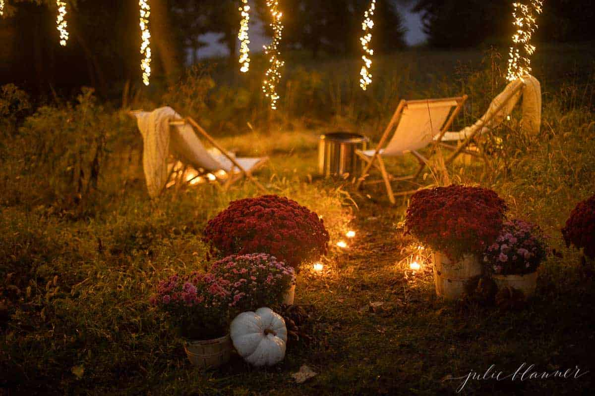 chairs by fire with candlelight mums and pumpkins