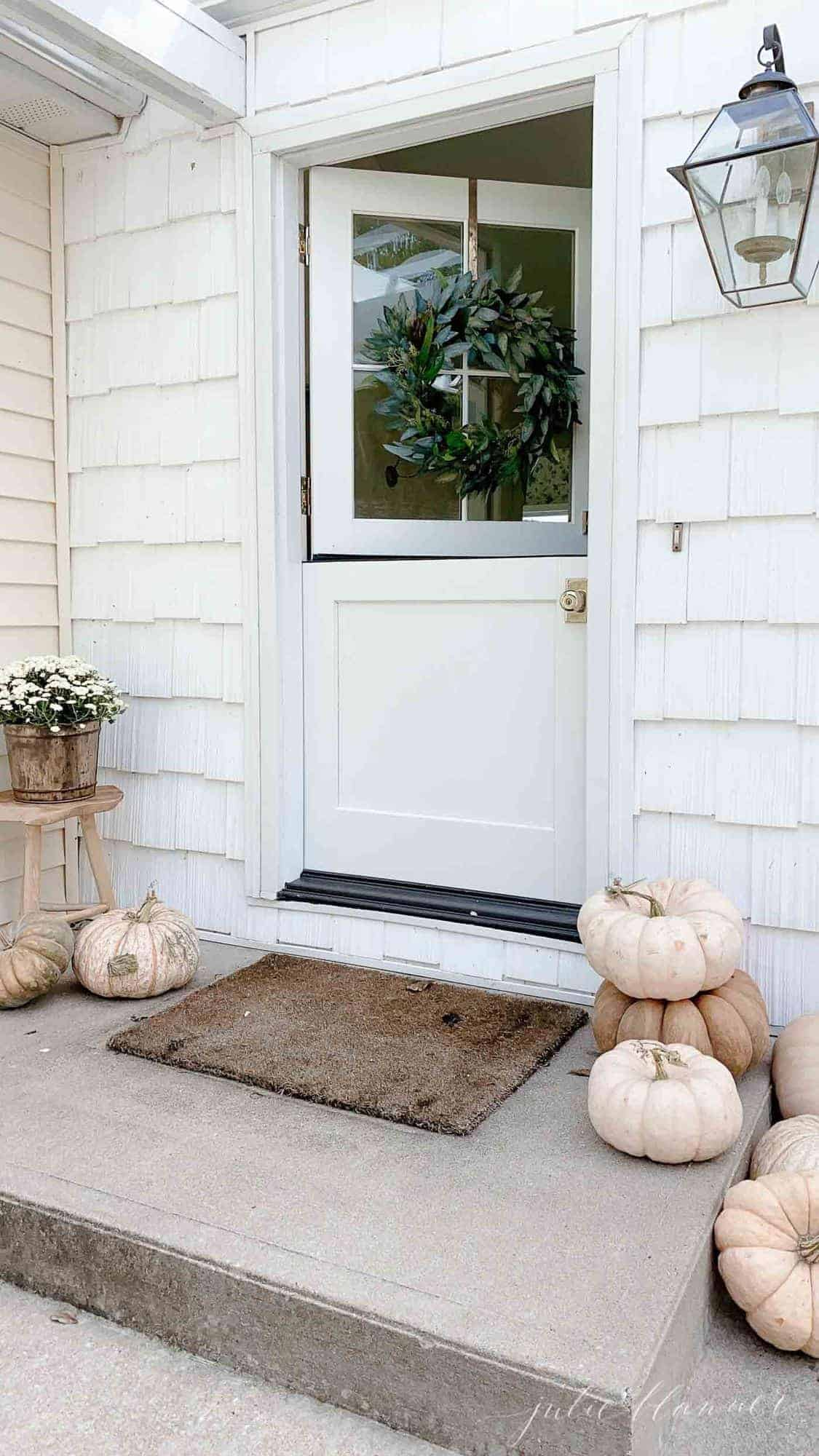 fall porch with pumpkins, mum fall wreath and dutch door
