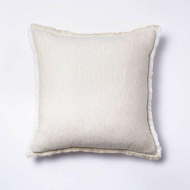 cream pillow with fringe trim