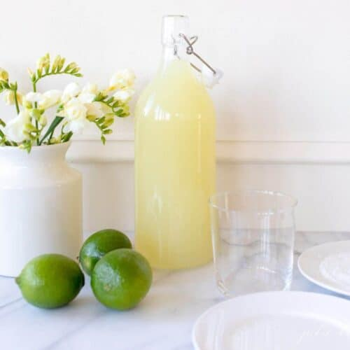 daisy mix next to the limes and the rim glass