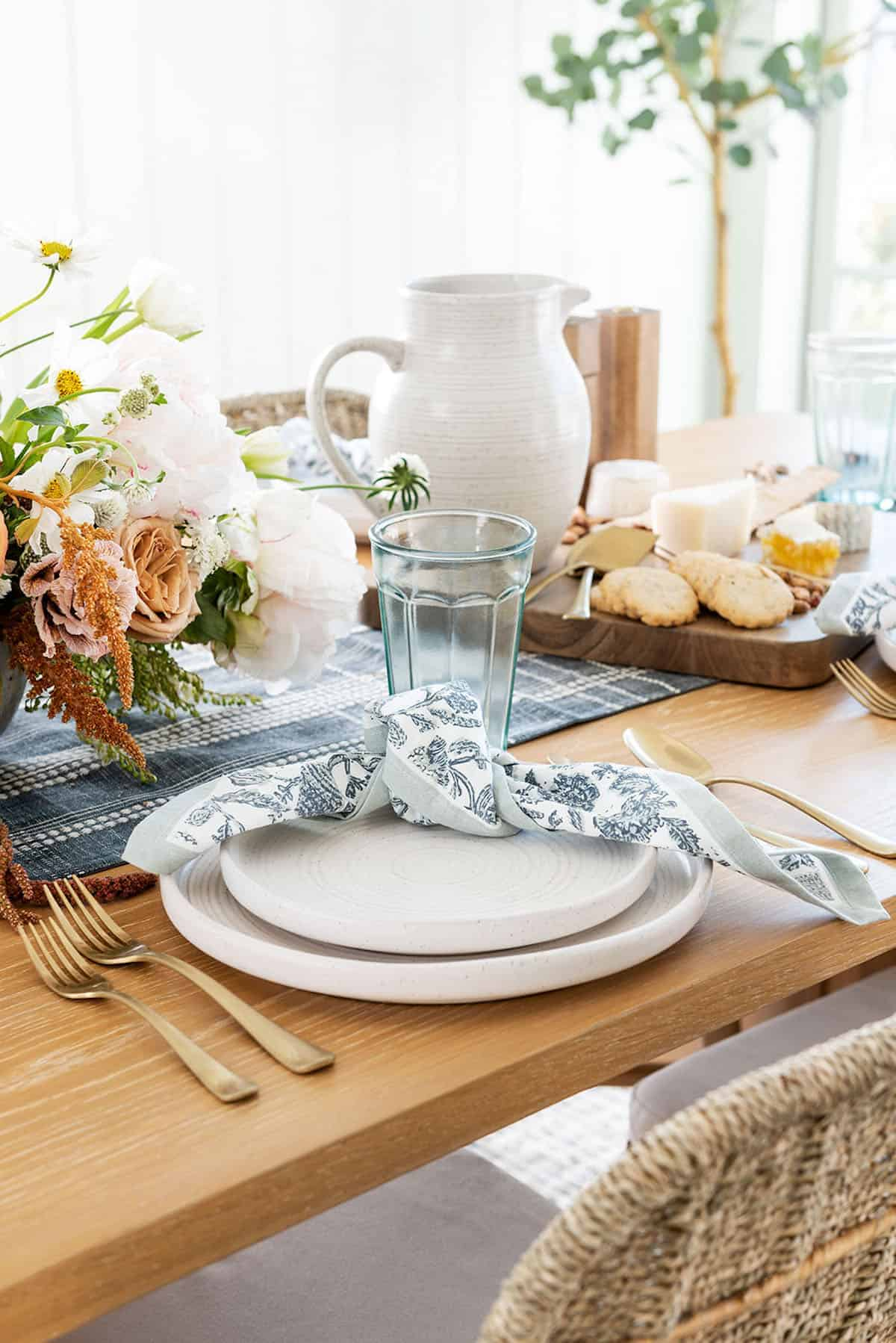 spring table setting with flowers plates and food