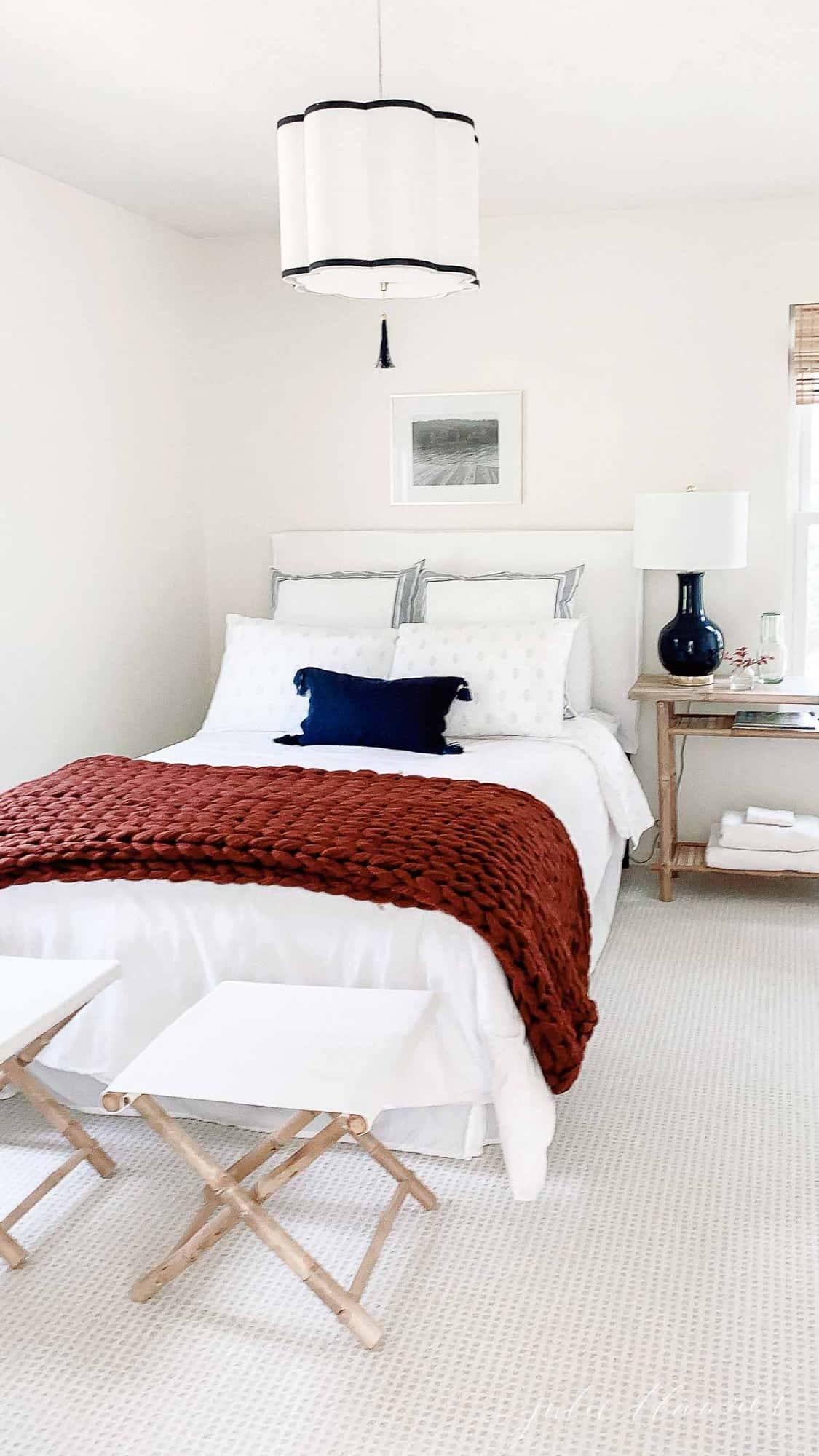navy and white bedroom with cozy throw
