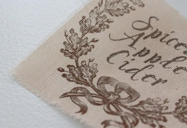A piece of fabric with a spiced apple cider label printed on it.