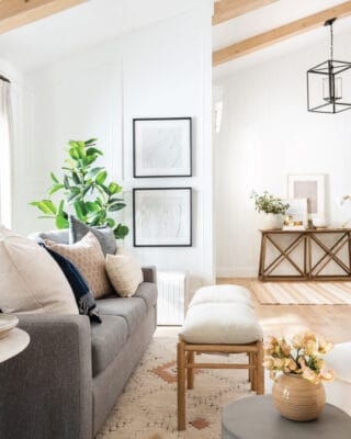 A living room and entryway decorated in neutral tones with pieces from the Studio McGee line at Target