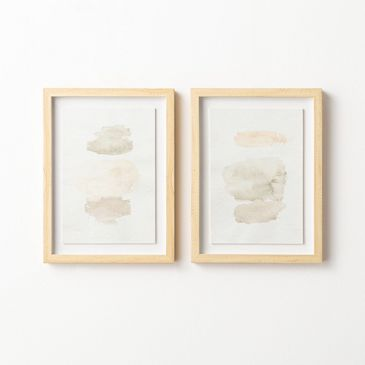 two pieces of water color art side by side
