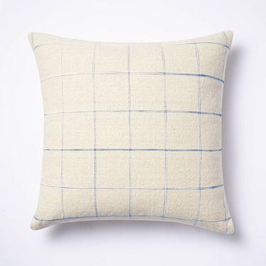 cream pillow with blue windowpane