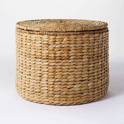 A round woven basket with a lid.