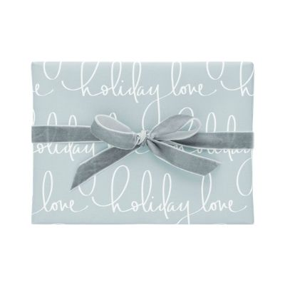 blue holiday gift wrap with velvet ribbon