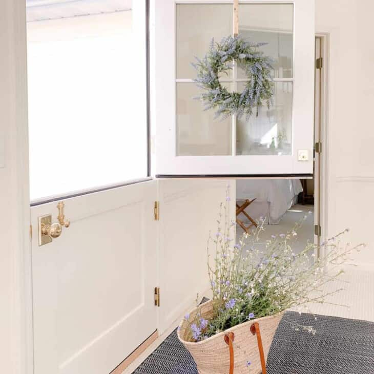 An indoor outdoor rug placed inside a home entry near the dutch door.