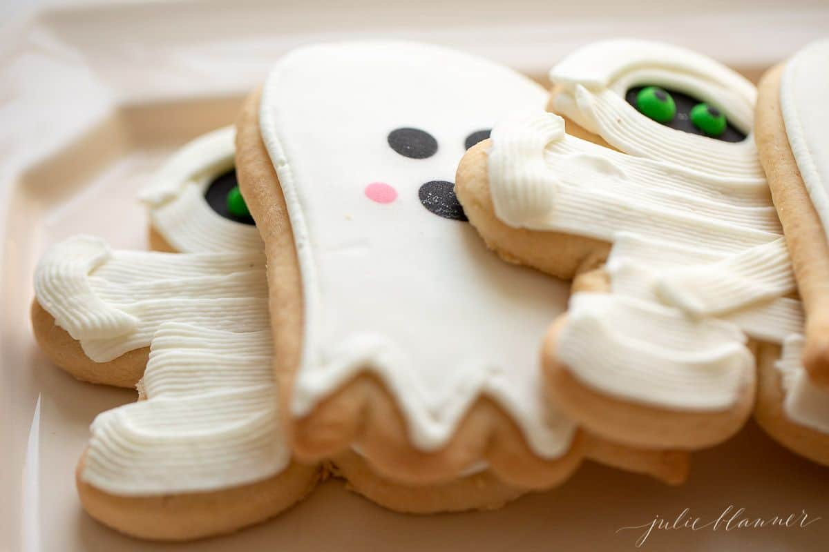 White decorated ghost and mummy sugar cookies.