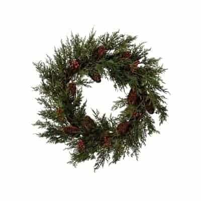 wreath with red berries and pinecones