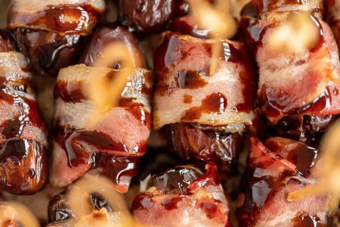 A pan full of baked bacon wrapped dates.
