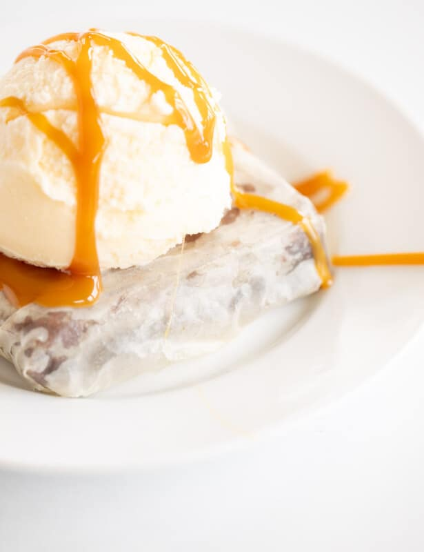 phyllo brownie on white plate topped with ice cream