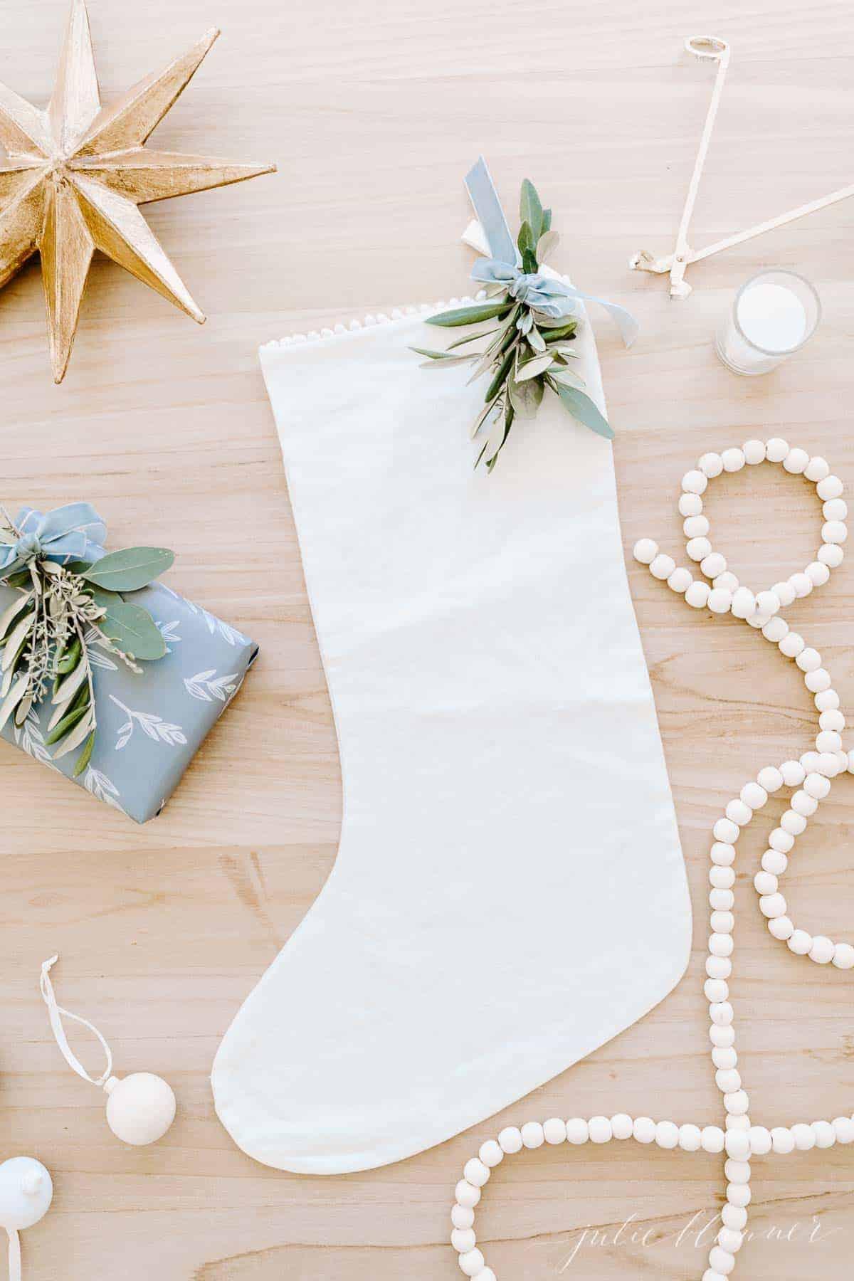flat lay of star stocking garland gift and greenery