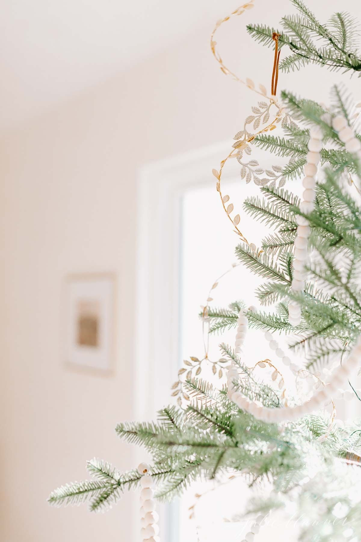 A Scandinavian sparse Christmas tree decorated very simply.