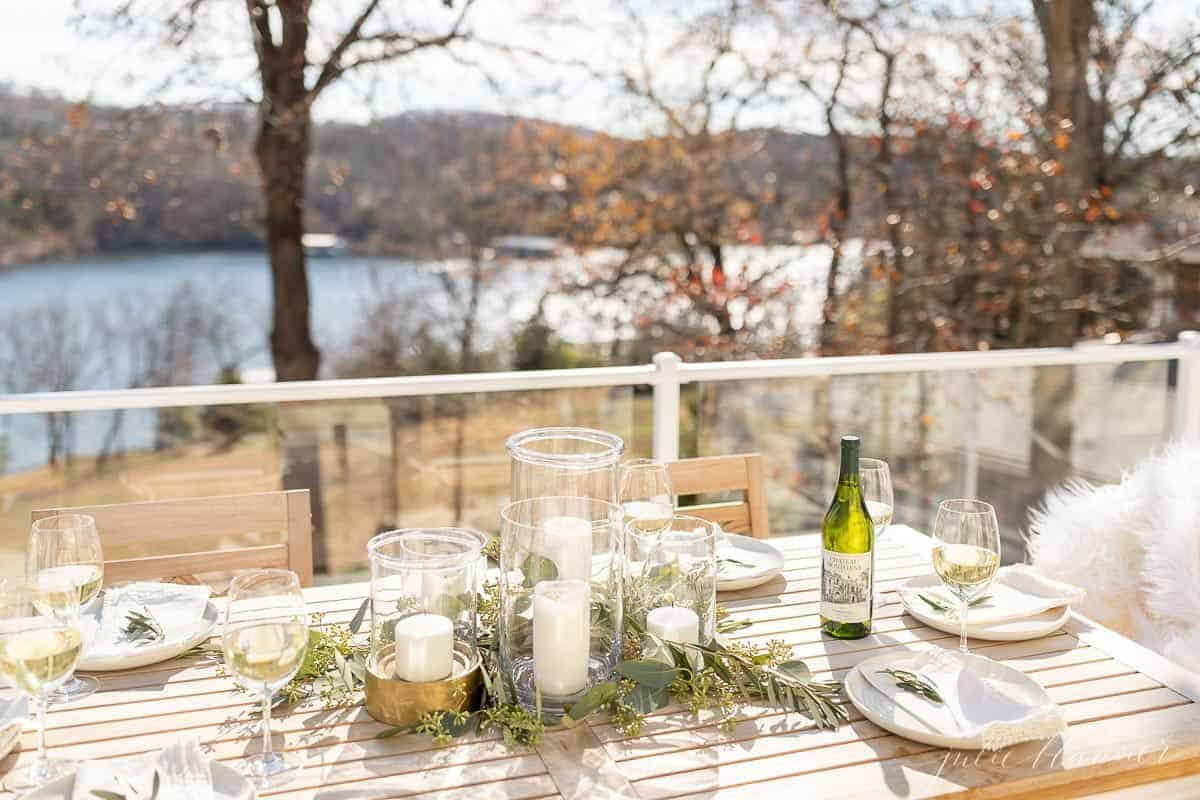 table set in front of glass deck panels exposing lake view