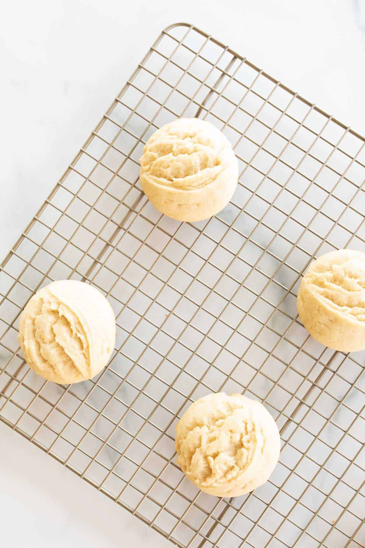 Amish sugar cookies on a wire cooling rack.