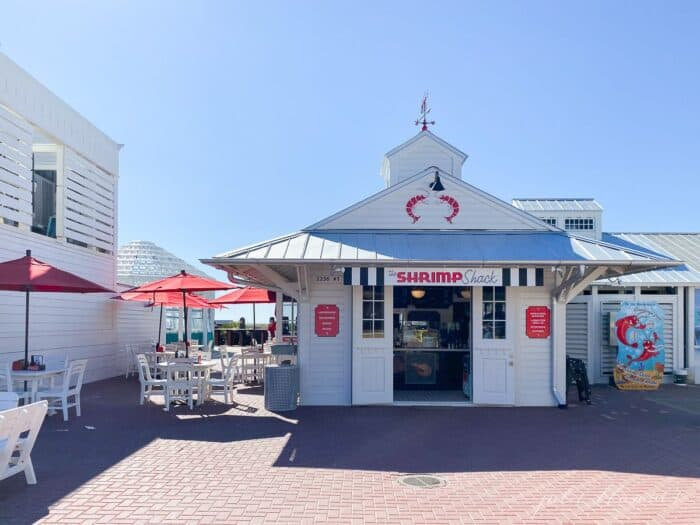 A charming white and red beach restaurant scene in Seaside Florida