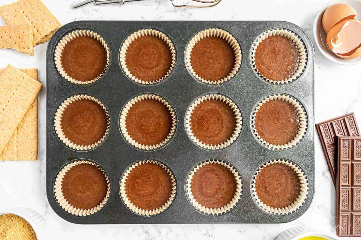 chocolate cupcake batter poured into liners in a cupcake pan.
