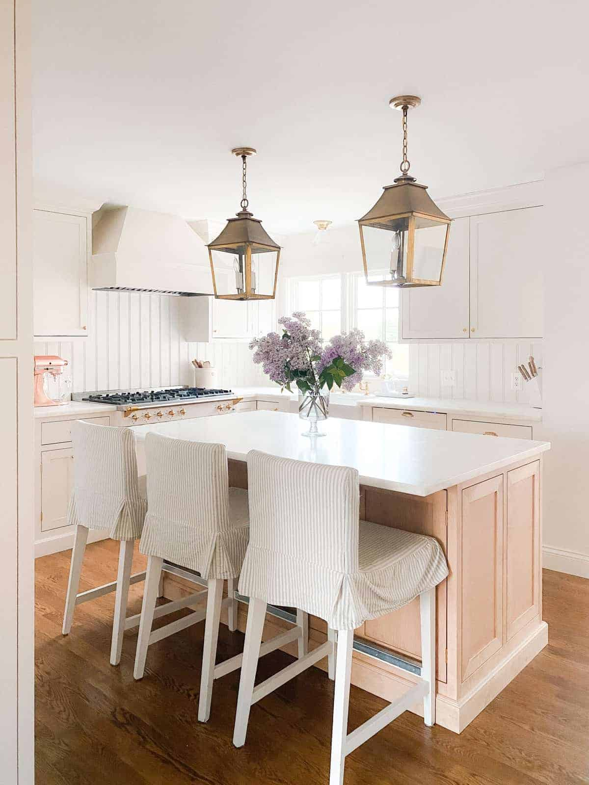 brass lanterns on the kitchen island