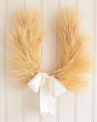 A wheat wreath on a beadboard background.