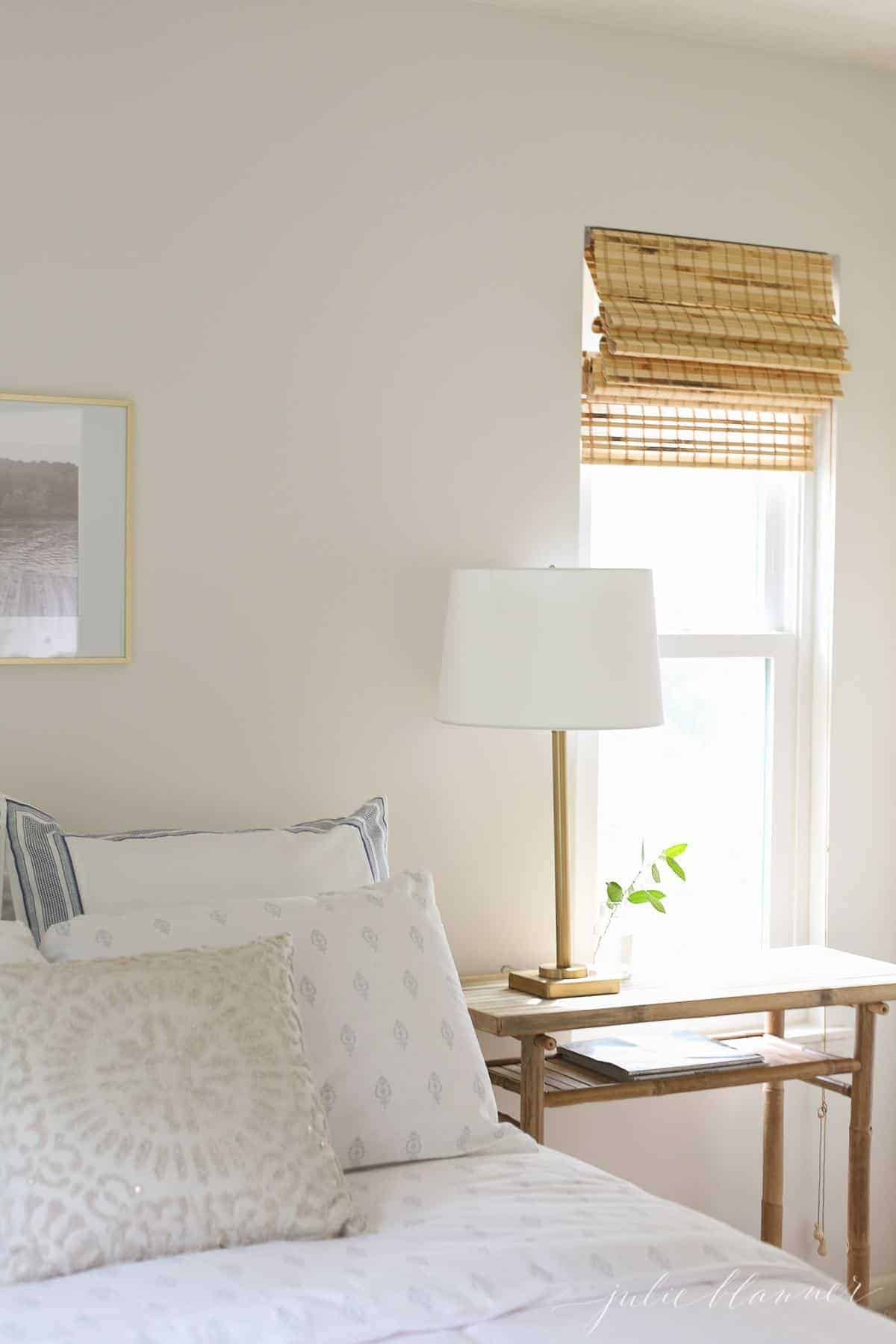 A white bedroom A living room with white furniture with a cream eggshell paint on the walls.