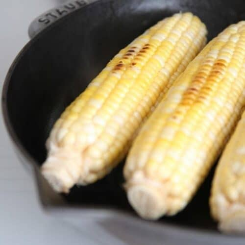 Grilled corn on the cob in a cast iron pan