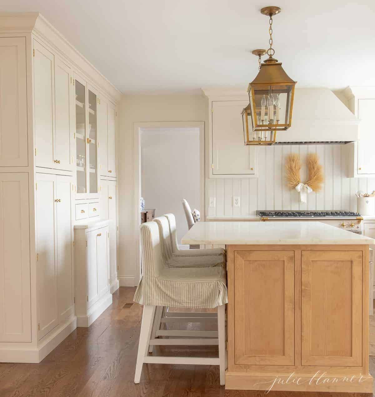 A white and wood kitchen with white beadboard.