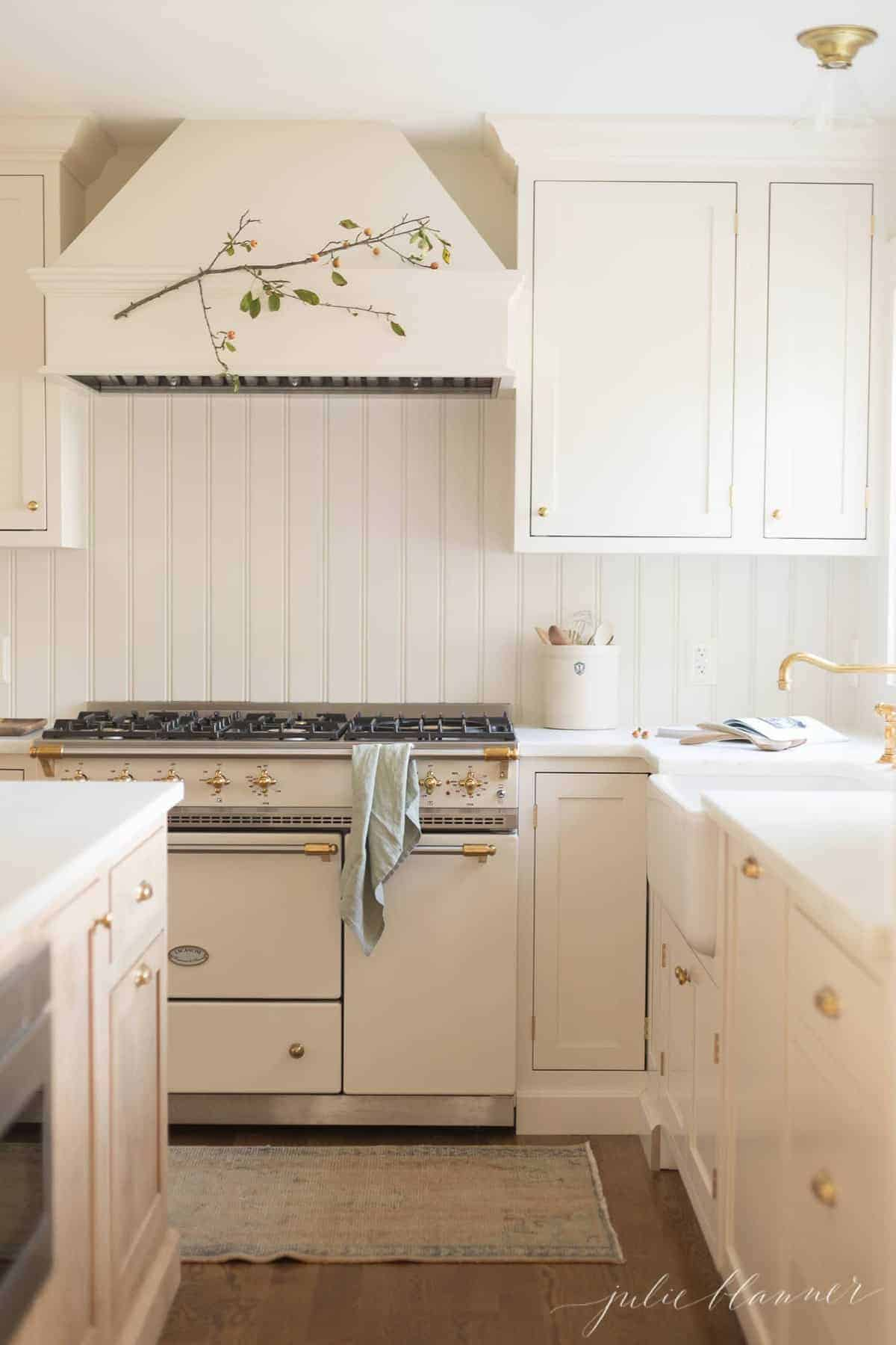 A cream and wood kitchen painted in a satin paint sheen on the cabinets.