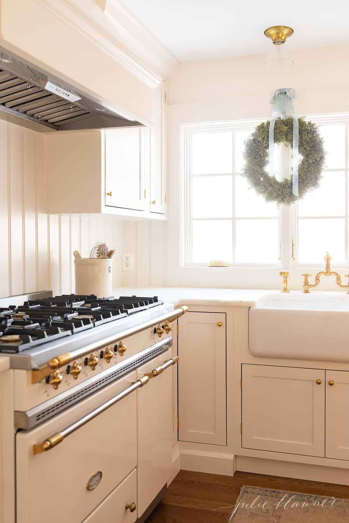 A white kitchen with shaker style kitchen cabinets.