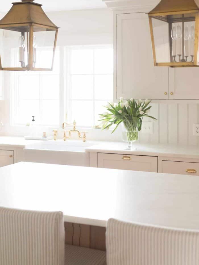 Carrara marble alternative danby marble countertops in a white kitchen.