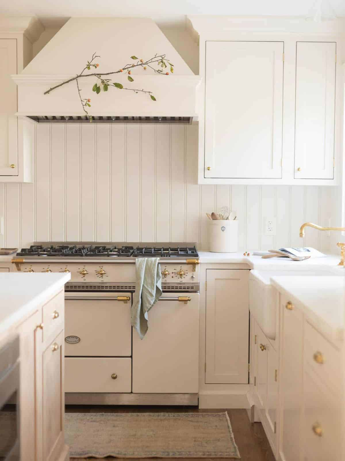 A cream kitchen with a Lacanche range and custom cabinets.