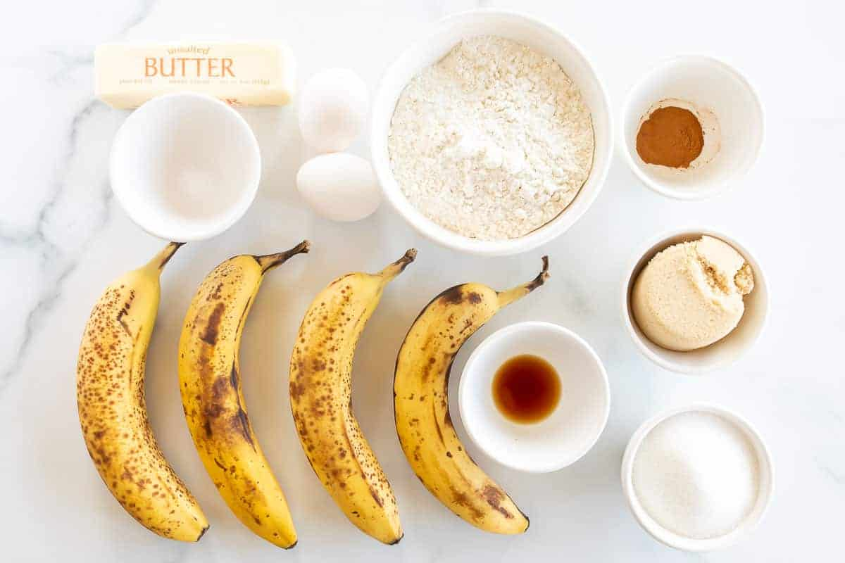 ingredients to make banana bread on marble surface