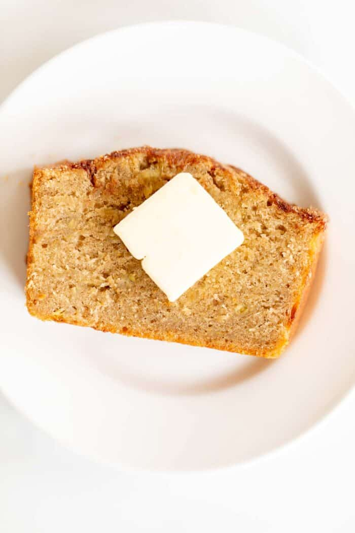 slice of banana bread with butter on top