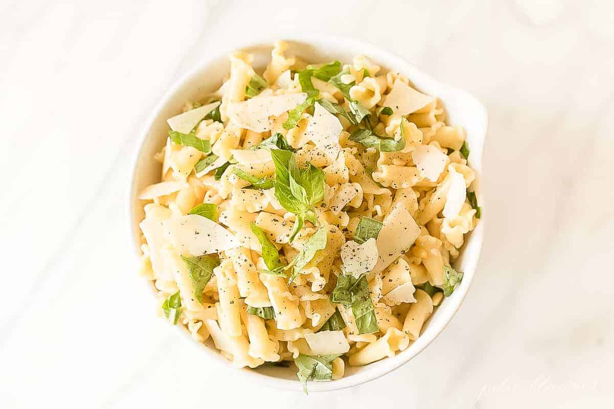 pasta salad topped with basil and parmesan