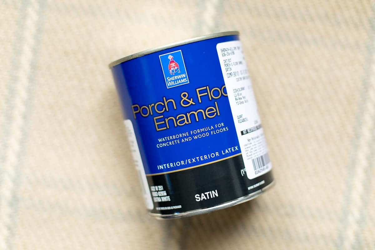 can of paint for vinyl or linoleum floors displayed on a plaid rug