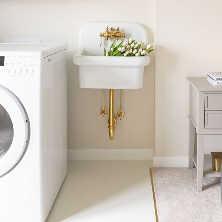 laundry room with painted linoleum floors