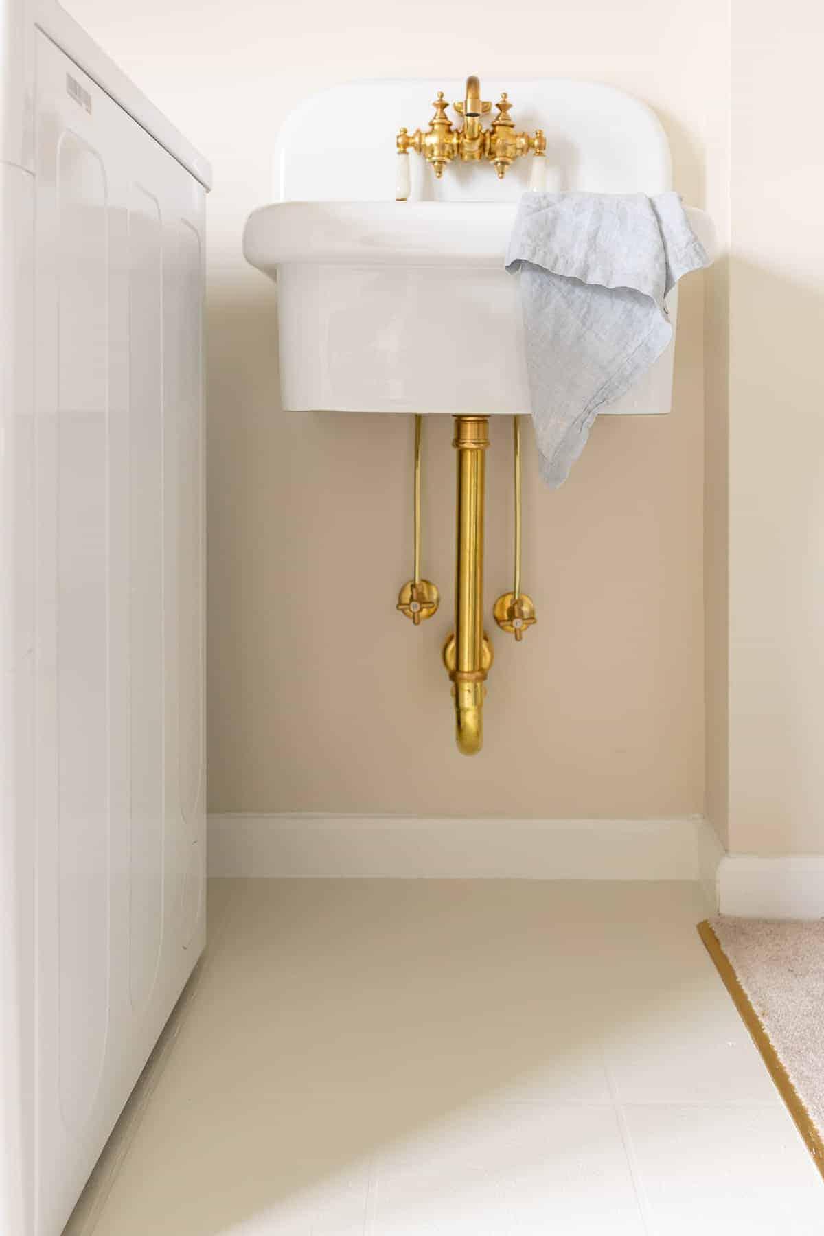 laundry room sink and painted linoleum floor