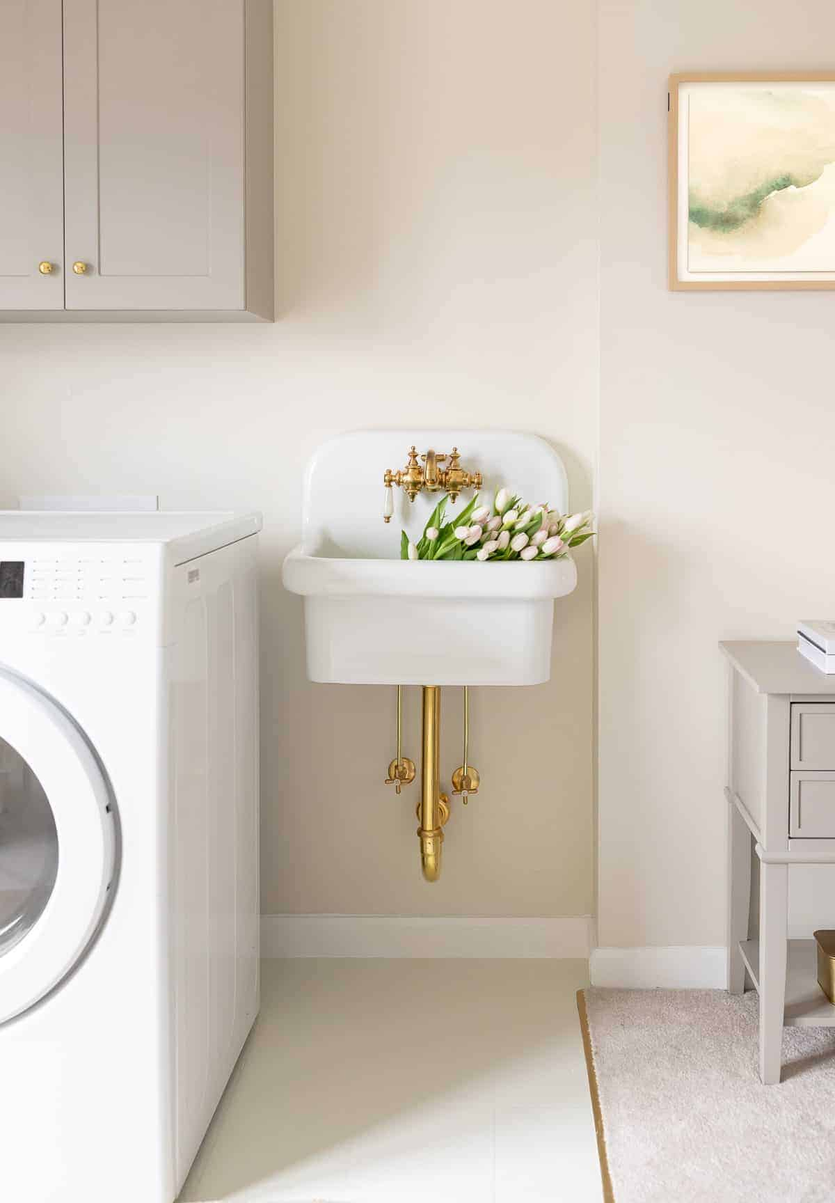 cream and gray laundry room with painted linoleum floor