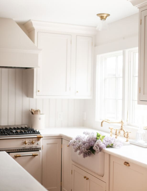 kitchen with walls and trim painted in the same color and flowers in the sink